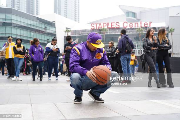 Los Angeles Lakers fan Victor Chavez of Los Angeles mourns the death of retired NBA star Kobe Bryant outside the Staples Center prior to the 62nd...