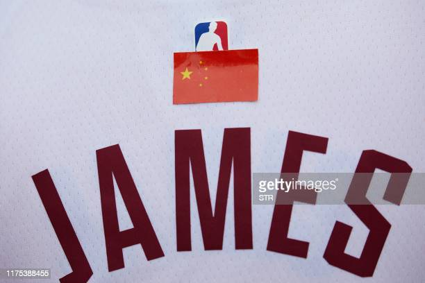 A Los Angeles Lakers fan wears a Lebron James shirt with a Chinese flag over the NBA logo before attending an National Basketball Association...