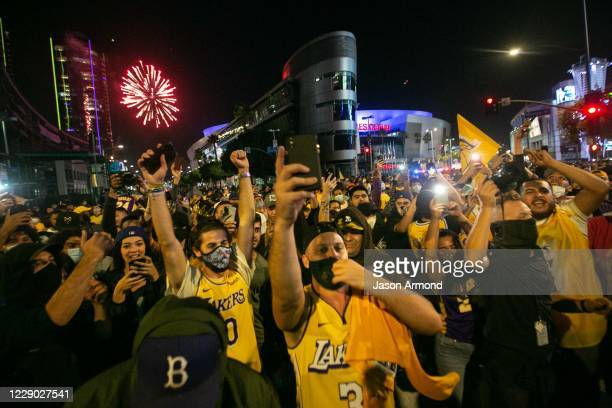 Los Angeles Lakers fans gather near the Staples Center to celebrate the Lakers 106 - 93 game 6 over the Miami Heat on Sunday, Oct. 11, 2020 in Los...