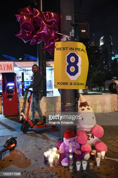 Los Angeles Lakers fans gather to remember NBA Star Kobe Bryant with makeshift memorials near Staples Center on January 26 2020 in Los Angeles...