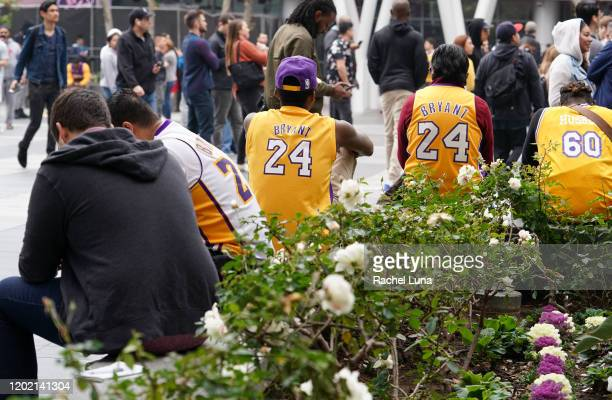 Los Angeles Lakers fans mourn the death of retired NBA star Kobe Bryant outside the Staples Center prior to the 62nd Annual Grammy Awards on January...