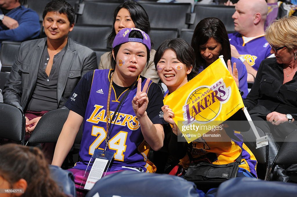 Los Angeles Lakers fans pose for a picture during the game against the Utah Jazz at Staples Center on January 25, 2013 in Los Angeles, California.