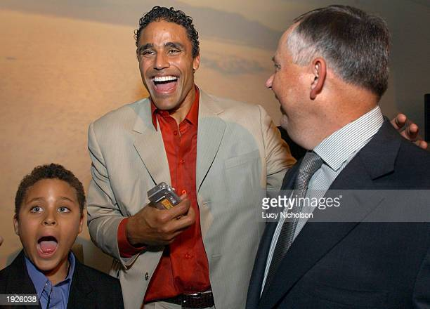 Los Angeles Lakers forward and actor Rick Fox Rick Fox and his son Kyle joke with Disney Executive Dick Cook at the postpremiere party of Holes on...