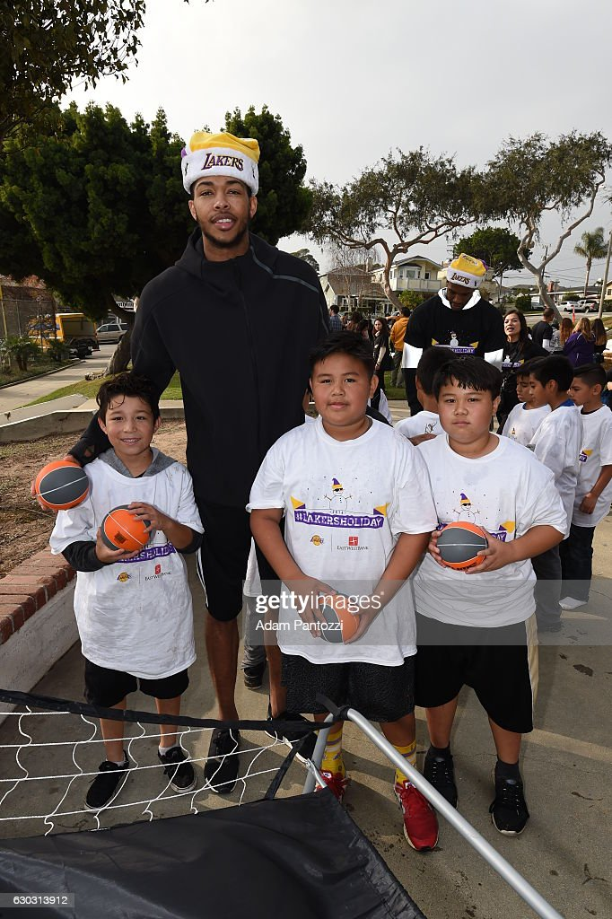 Los Angeles Lakers forward Brandon Ingram, along with other players, coaches, and the Laker Girls host a holiday party for 100 kids from LAs BEST at Gordon Clubhouse on December 10, 2016 in El Segundo, California.