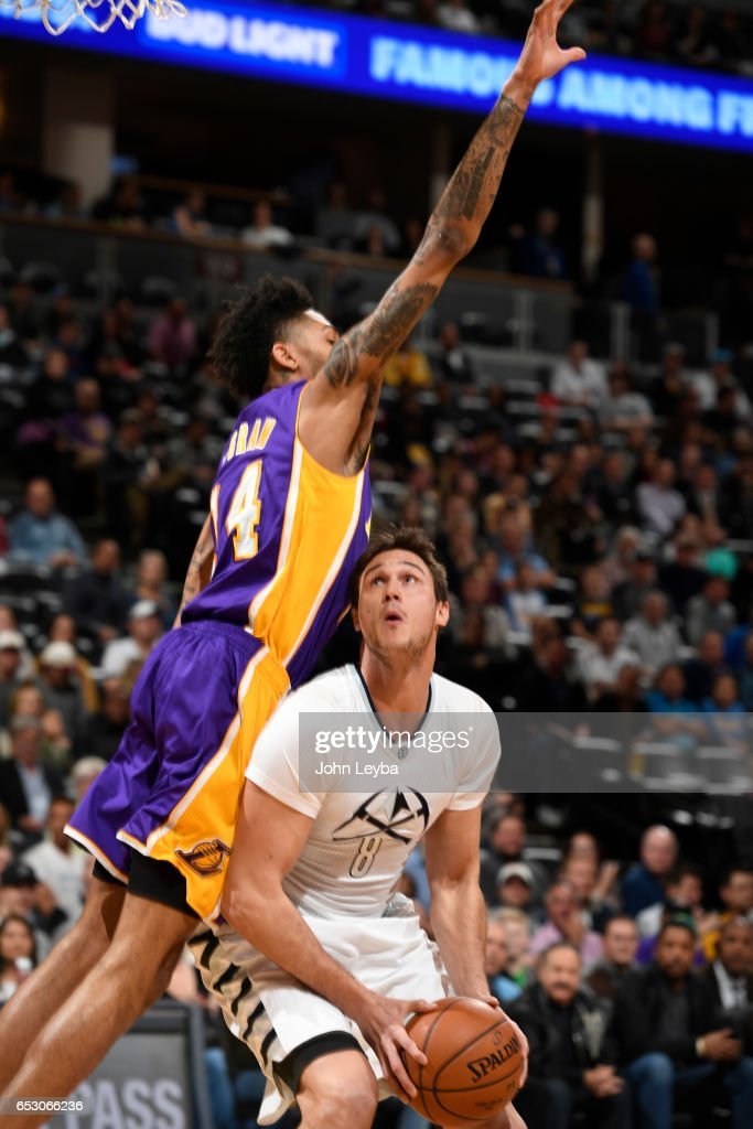 Los Angeles Lakers forward Brandon Ingram (14) goes up in an attempt to block a shot by Denver Nuggets forward Danilo Gallinari (8) during the first quarter on March 13, 2017 in Denver, Colorado at Pepsi Center.