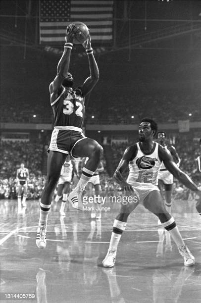 Los Angeles Lakers forward Cazzie Russell drives past Denver Nuggets guard Ted McClain for a layup during an NBA game at McNichols Arena on November...