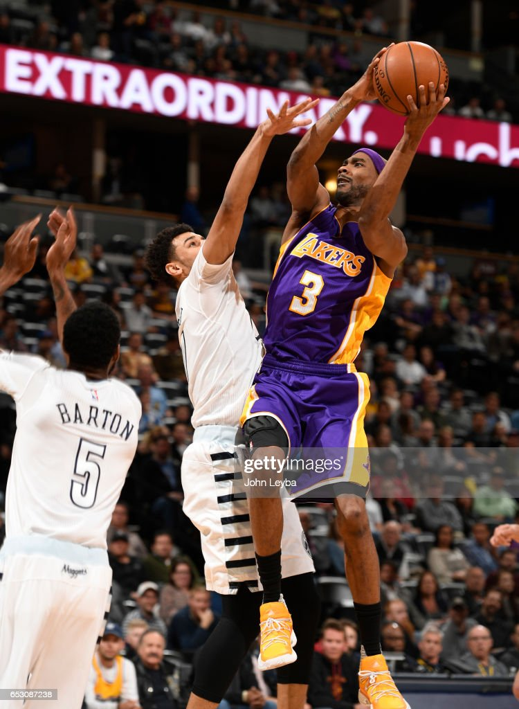 Los Angeles Lakers forward Corey Brewer (3) takes a shot pas Denver Nuggets guard Jamal Murray (27) during the fourth quarter on March 13, 2017 in Denver, Colorado at Pepsi Center.