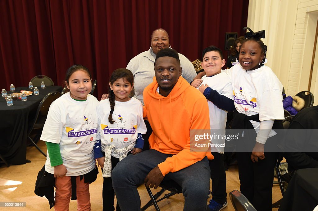 Los Angeles Lakers forward Julius Randle, along with other players, coaches, and the Laker Girls hosts a holiday party for 100 kids from LAs BEST at Gordon Clubhouse on December 10, 2016 in El Segundo, California.
