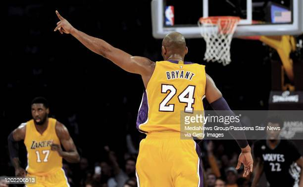 Los Angeles Lakers forward Kobe Bryant points after hitting a three point shot against the Minnesota Timberwolves in the second half of a NBA...