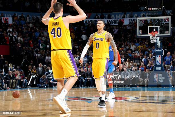 Los Angeles Lakers forward Kyle Kuzma and Los Angeles Lakers center Ivica Zubac react to a play during the game against the Oklahoma City Thunder on...