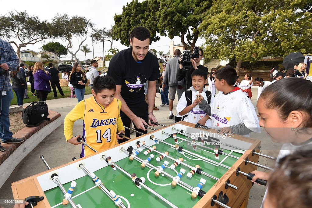 Los Angeles Lakers forward Larry Nance Jr., along with other players, coaches, and the Laker Girls hosts a holiday party for 100 kids from LAs BEST at Gordon Clubhouse on December 10, 2016 in El Segundo, California.