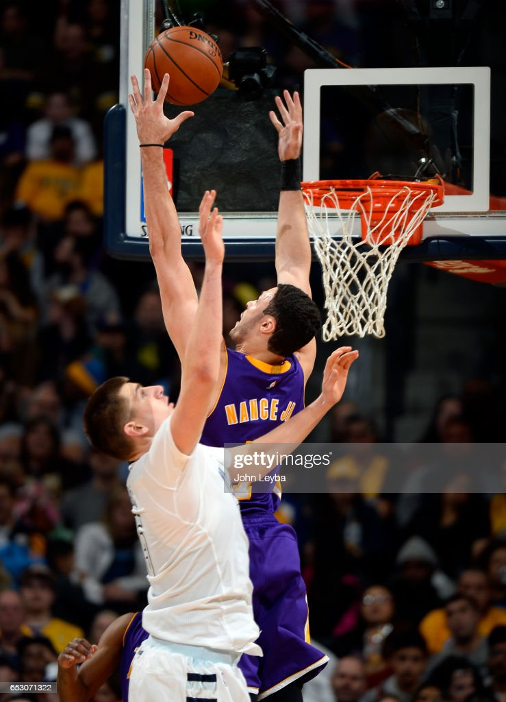 Los Angeles Lakers forward Larry Nance Jr. (7) goes up fro a rebound from Denver Nuggets forward Nikola Jokic (15) during the second quarter on March 13, 2017 in Denver, Colorado at Pepsi Center.