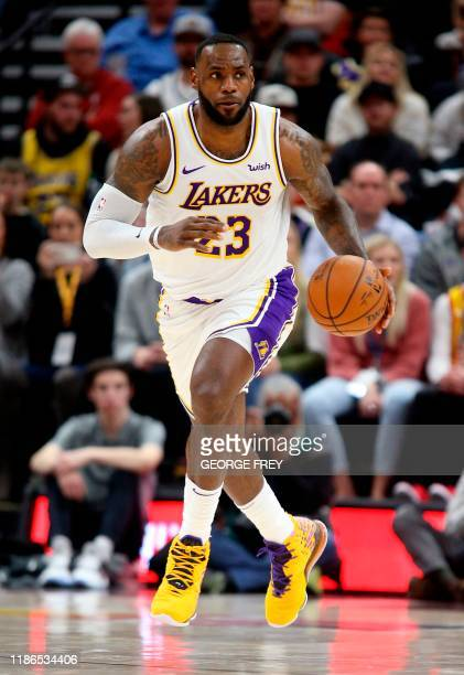 TOPSHOT Los Angeles Lakers forward LeBron James brings the ball down court during an NBA game against the Utah Jazz in Salt Lake City Utah on...