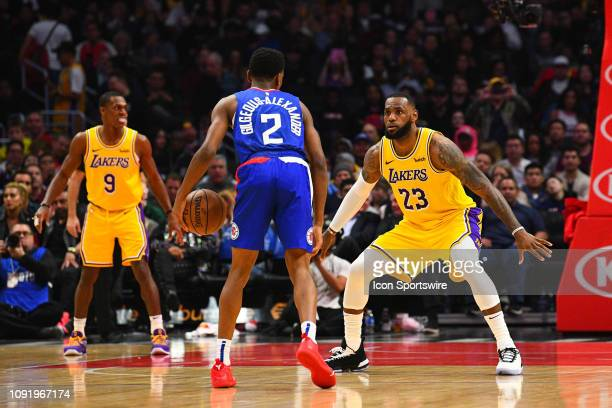 Los Angeles Lakers Forward LeBron James defends Los Angeles Clippers Guard Shai GilgeousAlexander during a NBA game between the Los Angeles Lakers...