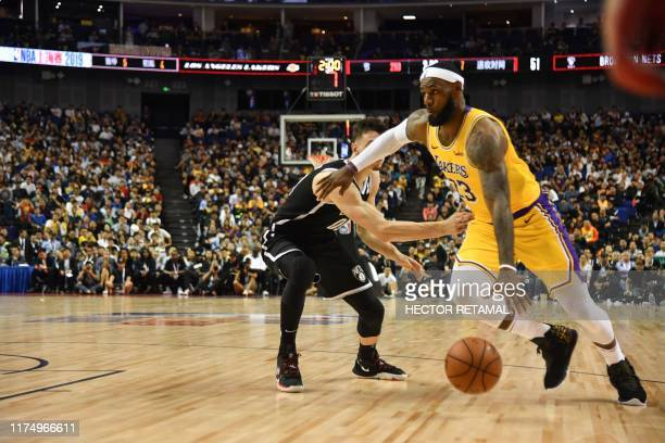 Los Angeles Lakers forward LeBron James drives to the basket during the National Basketball Association preseason match between the LA Lakers and...