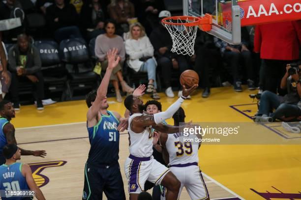 Los Angeles Lakers forward LeBron James goes under and up onDallas Mavericks center Boban Marjanovic during an NBA game between the Dallas Mavericks...