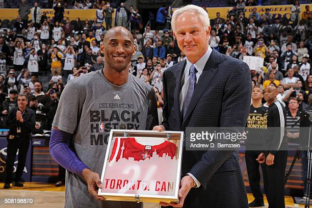 Los Angeles Lakers General Manager Mitch Kupchak presents Kobe Bryant of the Los Angeles Lakers with his 2016 NBA AllStar Jersey before the game...