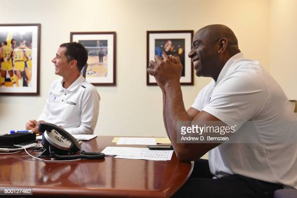 Los Angeles Lakers General Manager Rob Pelinka and President of Basketball Operations Magic Johnson meet in the draft room during the 2017 NBA Draft...