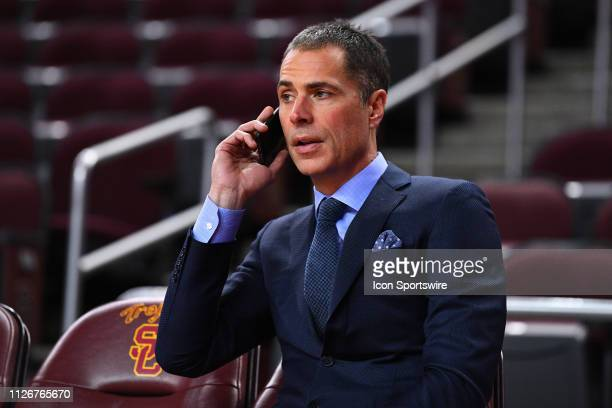 Los Angeles Lakers general manager Rob Pelinka talks on the phone before a college basketball game between the Oregon Ducks and the USC Trojans on...