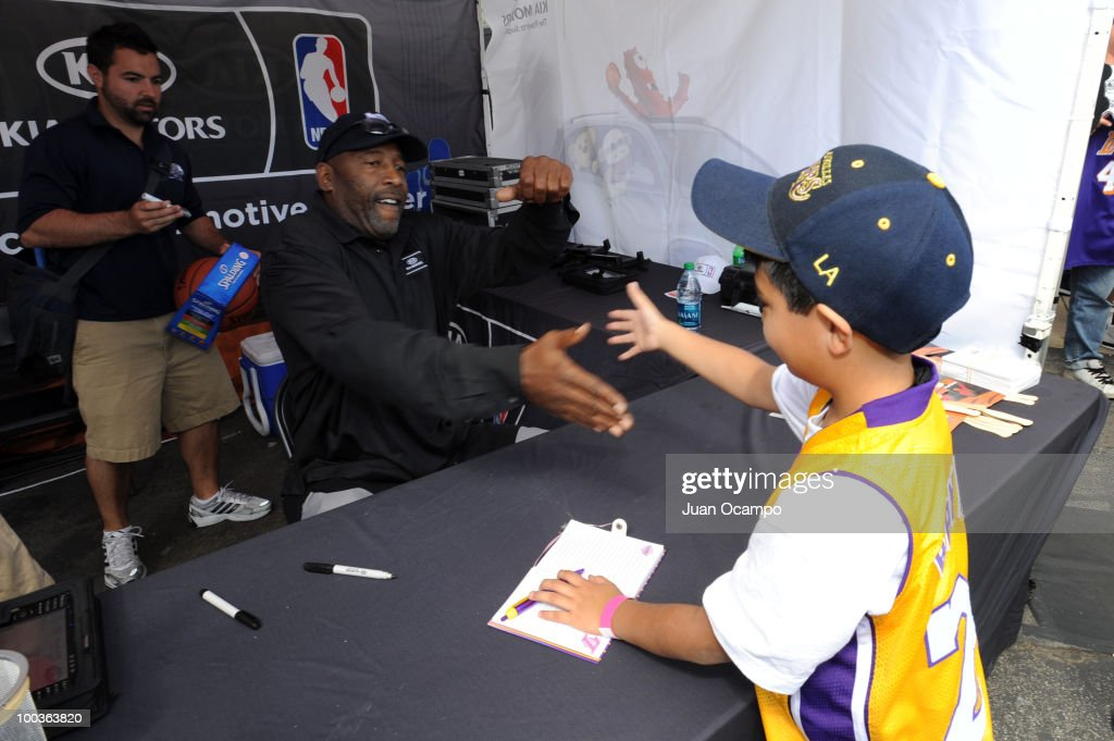 Los Angeles Lakers great James Worthy greets a fan during the NBA Nation Tour on May 23, 2010 at Universal City Walk in Universal City, California.