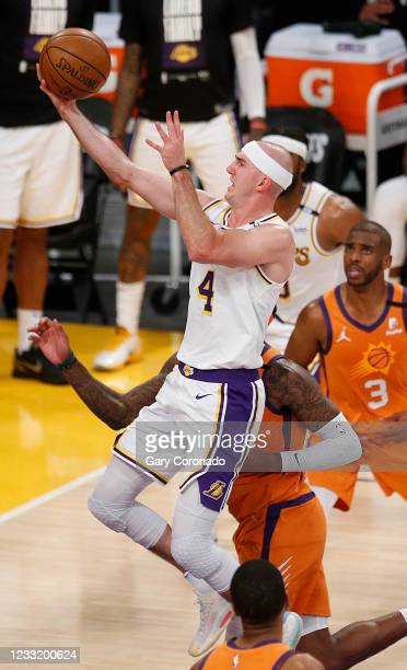 Los Angeles Lakers guard Alex Caruso scores guarded by Phoenix Suns forward Torrey Craig in the fourth quarter at the Staples Center on Sunday, May...