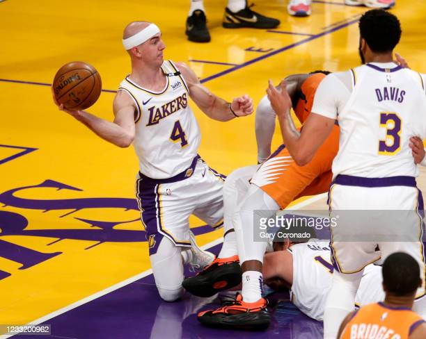 Los Angeles Lakers guard Alex Caruso scrambles for a loose ball in a game against the Phoenix Suns in the second quarter at the Staples Center on...