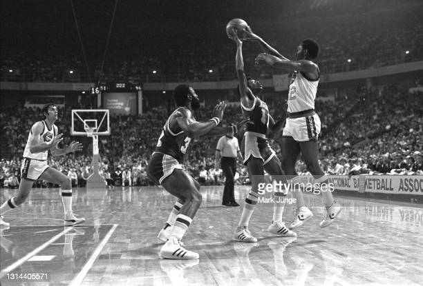 Los Angeles Lakers guard Bo Lamar blocks a pass by Denver Nuggets guard Ted McClain during an NBA game at McNichols Arena on November 24, 1976 in...