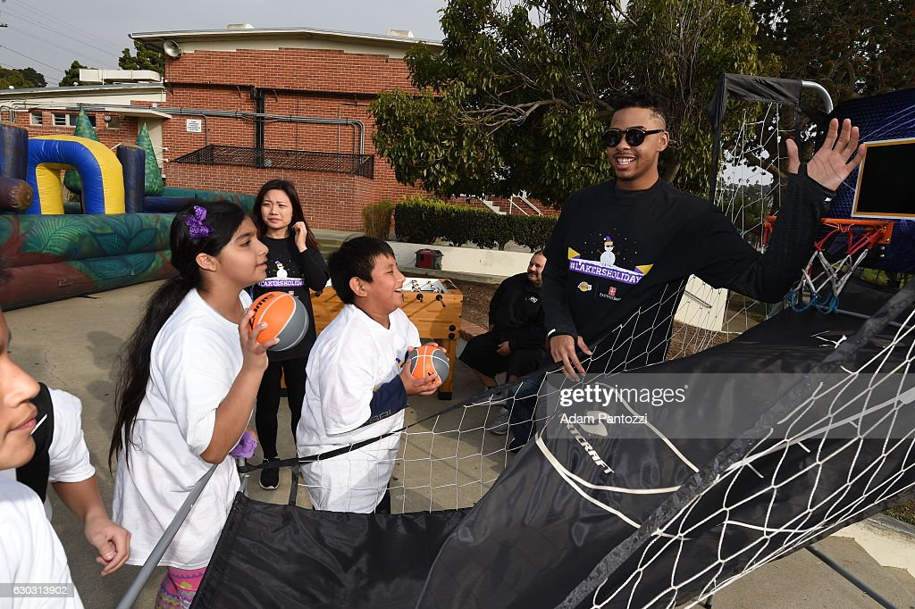 Los Angeles Lakers guard D'Angelo Russell, along with other players, coaches,. and the Laker Girls hosts a holiday party for 100 kids from LAs BEST at Gordon Clubhouse on December 10, 2016 in El Segundo, California.