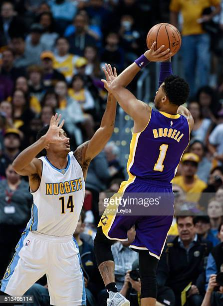 Los Angeles Lakers guard D'Angelo Russell takes a shot over Denver Nuggets guard Gary Harris during the first quarter March 2, 2016 at Pepsi Center.