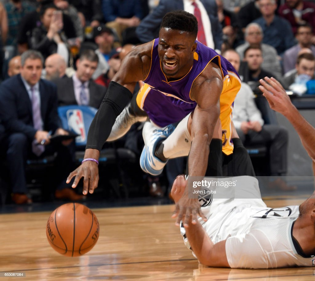Los Angeles Lakers guard David Nwaba (10) sails over Denver Nuggets forward Danilo Gallinari (8) as he loses control of the ball during the third quarter on March 13, 2017 in Denver, Colorado at Pepsi Center.