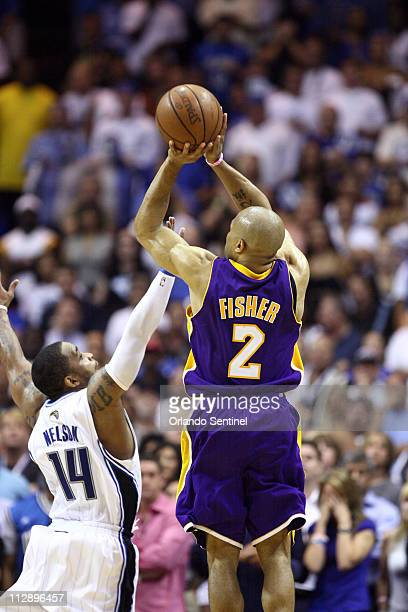 Los Angeles Lakers guard Derek Fisher hits a threepointer to tie the game at the end of the fourth quarter against the Orlando Magic during Game 4 of...