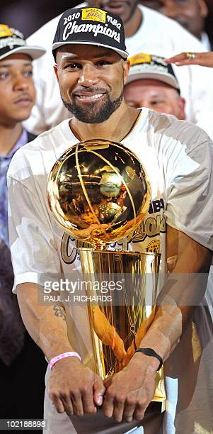 Los Angeles Lakers guard Derek Fisher holds the Larry O'Brien Trophy after the Lakers won the 2010 NBA Championship during Game 7 of the 2010 NBA...