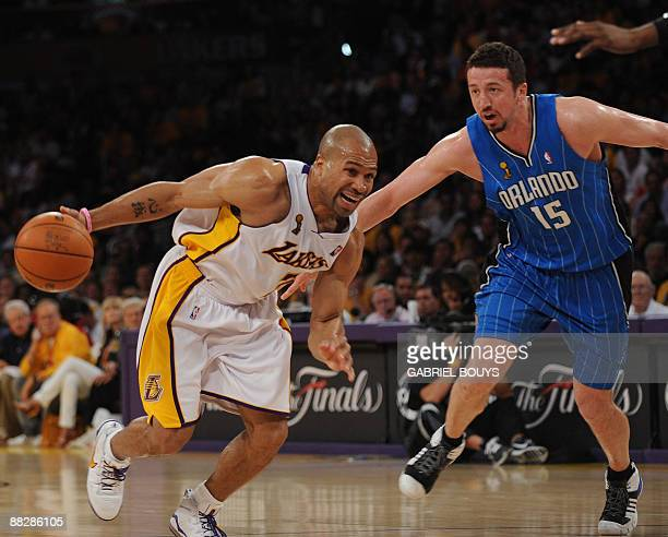 Los Angeles' Lakers guard Derek Fisher outpasses Orlando Magic's forward Hedo Turkoglu from Turkey during the Game 2 of the NBA final between Los...