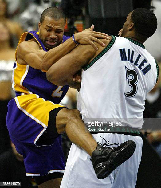 Los Angeles Lakers guard Derek Fisher runs into a hard screen from Minnesota Timberwolves center Oliver Miller during game 2 of the Western...