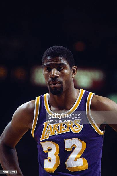 Los Angeles Lakers' guard Earvin 'Magic' Johnson pauses for a moment on the court NOTE TO USER User expressly acknowledges and agrees that by...
