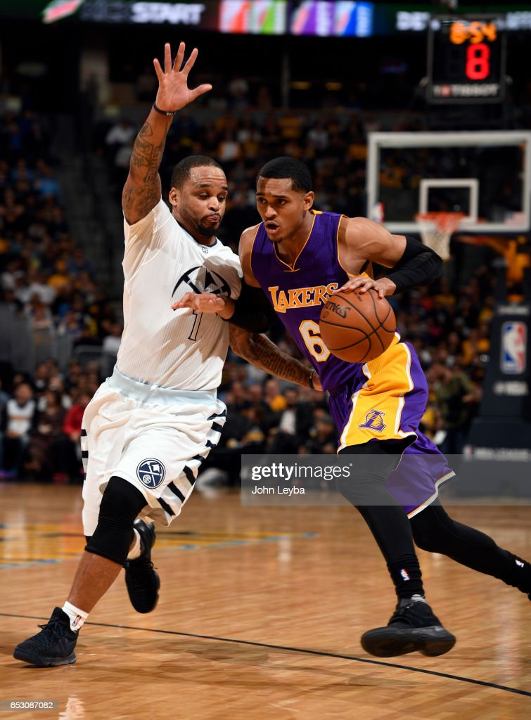 Los Angeles Lakers guard Jordan Clarkson (6) drives on Denver Nuggets guard Jameer Nelson (1) during the third quarter on March 13, 2017 in Denver, Colorado at Pepsi Center.