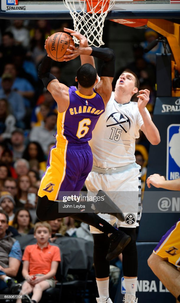 Los Angeles Lakers guard Jordan Clarkson (6) takes a shot over Denver Nuggets forward Nikola Jokic (15) during the first quarter on March 13, 2017 in Denver, Colorado at Pepsi Center.