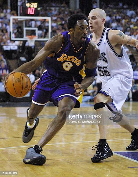 Los Angeles Lakers guard Kobe Bryant drives past Sacramento Kings guard Jason Williams during the first half of Game 3 of the Western Conference...
