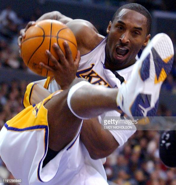 Los Angeles Lakers' guard Kobe Bryant hauls in a rebound against the Sacramento Kings in the second quarter in Los Angeles CA 25 December 2002 The...