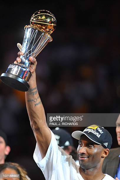 Los Angeles Lakers guard Kobe Bryant holds his MVP trophy after the Lakers won the 2010 NBA Championship during Game 7 of the 2010 NBA Finals between...