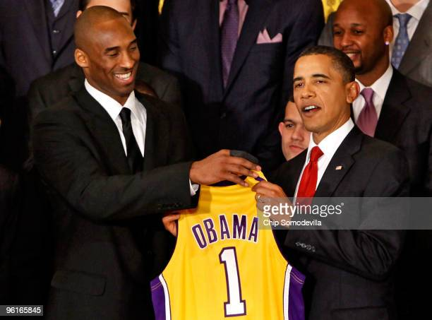 Los Angeles Lakers guard Kobe Bryant presents a jersey to President Barack Obama during an event with the National Basketball Association 2009...