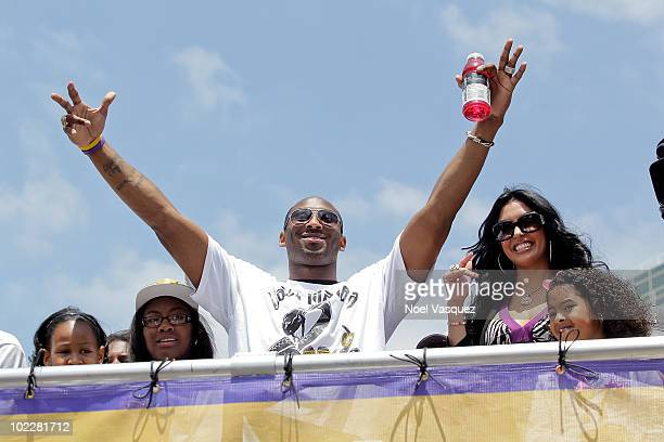 Los Angeles Lakers guard Kobe Bryant waves to the crowd while riding in the victory parade for the the NBA basketball champion team on June 21 2010...