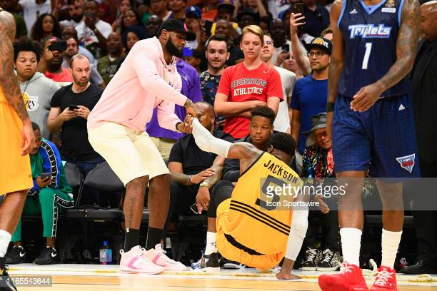 Los Angeles Lakers guard Lebron James helps up Killer 3s guard Stephen Jackson during the BIG3 championship game between the Tripletsand the Killer...