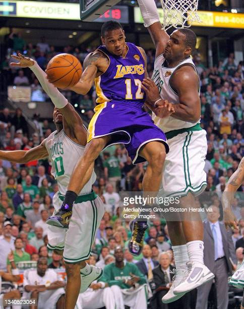 Los Angeles Lakers guard Shannon Brown goes up between Boston Celtics guard Ray Allen and forward Glen Davis during the fourth quarter of the NBA...