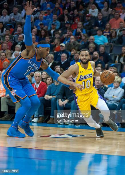 Los Angeles Lakers Guard Tyler Ennis driving to the basket while Oklahoma City Thunder Forward Carmelo Anthony plays defense during an NBA game...