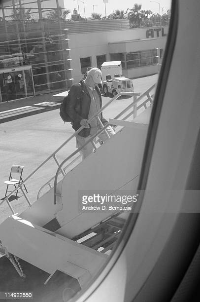 Los Angeles Lakers Head Coach Phil Jackson boards a plane on May 9 2010 en route to Salt Lake City Utah NOTE TO USER User expressly acknowledges and...