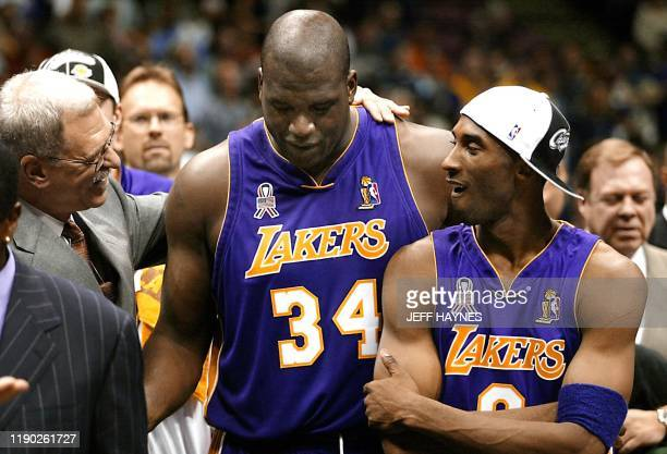 Los Angeles Lakers' head coach Phil Jackson celebrates with players Kobe Bryant and Shaquille O'Neal after game four of the NBA Finals against the...