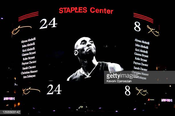 Los Angeles Lakers honor the nine victims from Sunday's helicopter crash during the pregame ceremony for Kobe Bryant before the game against the...