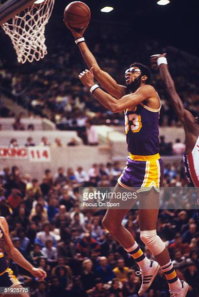 Los Angeles Lakers' Kareem Abdul Jabbar jumps to make a hook shot against the New York Nets at Madison Square Garden in December 1979 in New York New...