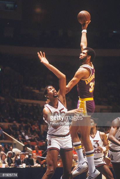 Los Angeles Lakers' Kareem Abdul Jabbar makes a hook shot against New York Nets' center Bill Cartwright at Madison Square Garden circa 1980's in New...